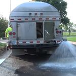 Water truck spraying water onto the ground